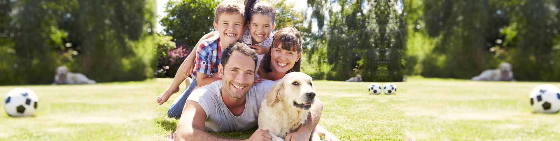 family relaxing in garden with pet
